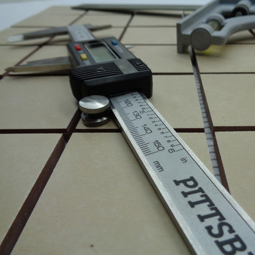 Image of a mosaic with measuring tools