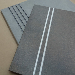 Image of stair treads with contrasting color glaze in the anti-slip safety grooves
