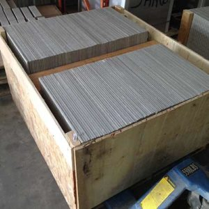 Image of re-sized tile stacked in a custom crate awaiting shipment