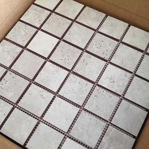 Image of mesh mounted mosaics ready for shipment