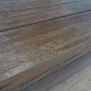 Image of stacks of bullnosed wood look plank tiles with wood look glazing