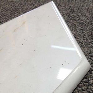 Image of a diamond shaped tile piece with ogee edge