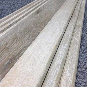 Image of wood look plank tiles with wood look glazing on the bullnose edge.