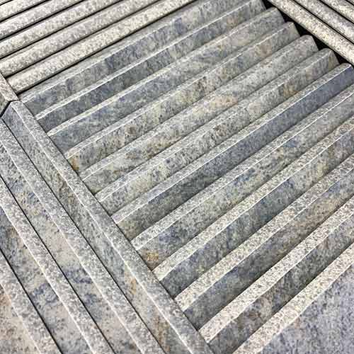 Image of racked pool tiles with a bullnose edge
