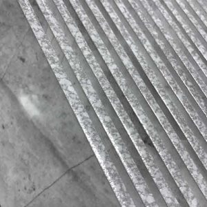 Image of speckled high gloss bullnose pieces