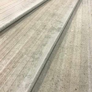 Image of distressed concrete look tile with a bullnose edge