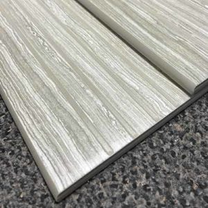 Image of stair tread with color matched glaze in the anti slip grooves