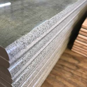 Image of speckled glaze technique on the bullnose edge of some high gloss bullnose tile pieces