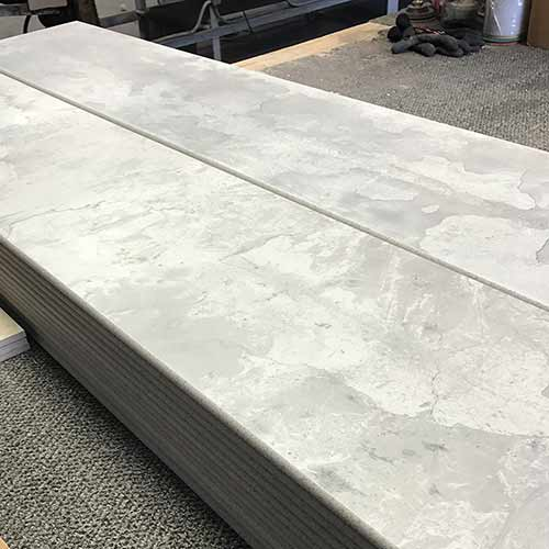 Image of large format bullnose tile pieces