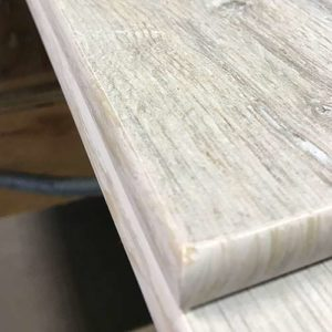 Image of corner bullnose on a wood look tile